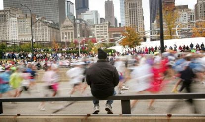 A spectator watches the start of the Chicago Marathon