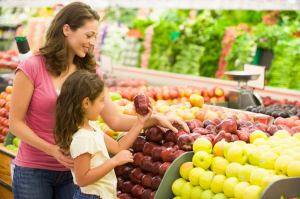 bigstock-Woman-And-Child-Choosing-Fruit-3915652
