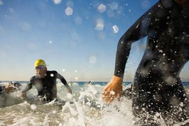 Swimmers in Triathlon --- Image by © Robert Michael/Corbis